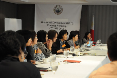 Participants in the Gender and Development (GAD) Planning Workshop listen and respond intensely  on  the objective  of  the gender issue identification,  spells out the result that the agency intends to achieve in terms of addressing the gender issue.